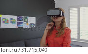 Купить «Female executive using virtual reality headset in a modern office 4k», видеоролик № 31715040, снято 12 марта 2019 г. (c) Wavebreak Media / Фотобанк Лори