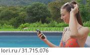 Купить «Woman in swimwear using mobile phone in the backyard 4k», видеоролик № 31715076, снято 12 марта 2019 г. (c) Wavebreak Media / Фотобанк Лори