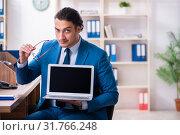 Купить «Young handsome businessman sitting in the office», фото № 31766248, снято 29 марта 2019 г. (c) Elnur / Фотобанк Лори