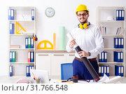 Купить «Young male architect working in the office», фото № 31766548, снято 25 февраля 2019 г. (c) Elnur / Фотобанк Лори