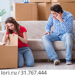 Купить «Young pair moving in to new house with boxes», фото № 31767444, снято 17 апреля 2017 г. (c) Elnur / Фотобанк Лори