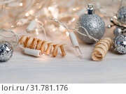 White christmas lights on retro vintage wooden background with shallow focus. Стоковое фото, фотограф Zoonar.com/Artush Foto / easy Fotostock / Фотобанк Лори