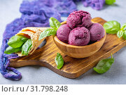 Blueberry ice cream balls and green basil in a wooden bowl. Стоковое фото, фотограф Марина Сапрунова / Фотобанк Лори