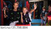 Купить «Girl and boy with laser guns on lasertag arena», фото № 31798884, снято 15 октября 2019 г. (c) Яков Филимонов / Фотобанк Лори