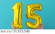 Купить «Gold foil number 15 celebration balloon», видеоролик № 31813548, снято 24 июля 2019 г. (c) Ekaterina Demidova / Фотобанк Лори