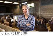 Купить «Positive woman owner of dairy farm», фото № 31813904, снято 15 декабря 2018 г. (c) Яков Филимонов / Фотобанк Лори