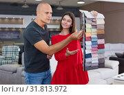 Купить «Consultant helping man choosing upholstery fabric», фото № 31813972, снято 29 октября 2018 г. (c) Яков Филимонов / Фотобанк Лори