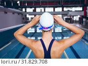 Купить «Young swimmer in a swimming stadium», фото № 31829708, снято 24 марта 2019 г. (c) Wavebreak Media / Фотобанк Лори