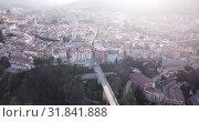 Купить «Aerial view of Alcoi cityscape with blue dome of Archpriest church of Santa Maria, Spain», видеоролик № 31841888, снято 16 апреля 2019 г. (c) Яков Филимонов / Фотобанк Лори