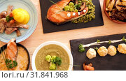 Купить «Dishes of traditional Norwegian cuisine with lamb rib, seafood and vegetables served at plates», видеоролик № 31841968, снято 27 августа 2018 г. (c) Яков Филимонов / Фотобанк Лори