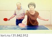 Купить «Happy mature spousesn playing table tennis», фото № 31842912, снято 22 сентября 2017 г. (c) Татьяна Яцевич / Фотобанк Лори