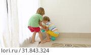 children fighting and sharing a toy. Стоковое видео, видеограф Ekaterina Demidova / Фотобанк Лори