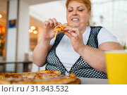 Купить «Fatty woman eating pizza with french fries», фото № 31843532, снято 24 мая 2019 г. (c) Tryapitsyn Sergiy / Фотобанк Лори