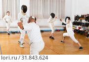 Купить «Adults and teens wearing fencing uniform practicing with foil», фото № 31843624, снято 30 мая 2018 г. (c) Яков Филимонов / Фотобанк Лори