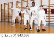 Купить «Fencing instructor with young fencers in training room», фото № 31843636, снято 30 мая 2018 г. (c) Яков Филимонов / Фотобанк Лори
