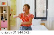 Купить «happy little girl dancing in her room at home», видеоролик № 31844672, снято 21 июля 2019 г. (c) Syda Productions / Фотобанк Лори