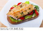 Купить «Sandwich with guacamole, trout fillet, sweet pepper», фото № 31845532, снято 23 августа 2019 г. (c) Яков Филимонов / Фотобанк Лори