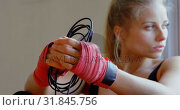 Купить «Female boxer relaxing in fitness studio 4k», видеоролик № 31845756, снято 6 сентября 2018 г. (c) Wavebreak Media / Фотобанк Лори