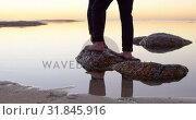 Купить «Couple standing on rock near sea 4k», видеоролик № 31845916, снято 10 сентября 2018 г. (c) Wavebreak Media / Фотобанк Лори