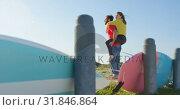 Купить «Young man giving woman piggyback on beach 4k», видеоролик № 31846864, снято 20 сентября 2018 г. (c) Wavebreak Media / Фотобанк Лори