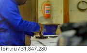 Купить «Worker working at table in workshop 4k», видеоролик № 31847280, снято 27 сентября 2018 г. (c) Wavebreak Media / Фотобанк Лори