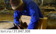 Купить «Worker inserting pipe in mold 4k», видеоролик № 31847308, снято 27 сентября 2018 г. (c) Wavebreak Media / Фотобанк Лори