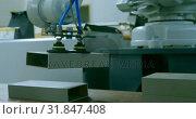 Купить «Robotic machine in warehouse 4k», видеоролик № 31847408, снято 4 октября 2018 г. (c) Wavebreak Media / Фотобанк Лори
