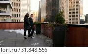 Купить «Mixed race Business people interacting with each other in the balcony of hotel 4k», видеоролик № 31848556, снято 14 октября 2018 г. (c) Wavebreak Media / Фотобанк Лори