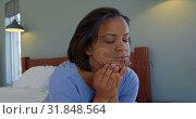 Купить «Front view of mature Caucasian woman sitting on bed in comfortable home 4k», видеоролик № 31848564, снято 7 ноября 2018 г. (c) Wavebreak Media / Фотобанк Лори