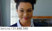 Купить «Front view of young mixed-race woman looking at camera in a comfortable home 4k», видеоролик № 31848580, снято 7 ноября 2018 г. (c) Wavebreak Media / Фотобанк Лори