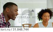Купить «Black couple praying together at home 4k», видеоролик № 31848744, снято 7 ноября 2018 г. (c) Wavebreak Media / Фотобанк Лори