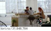 Купить «Young cool mixed-race business team planning and sitting in cafeteria of modern office 4k», видеоролик № 31848784, снято 6 октября 2018 г. (c) Wavebreak Media / Фотобанк Лори