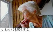 Купить «Side view of thoughtful old Caucasian senior woman sitting near window at home 4k», видеоролик № 31857812, снято 6 ноября 2018 г. (c) Wavebreak Media / Фотобанк Лори