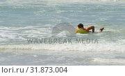 Купить «Male surfer surfing with surfboard in the sea at beach 4k», видеоролик № 31873004, снято 14 ноября 2018 г. (c) Wavebreak Media / Фотобанк Лори