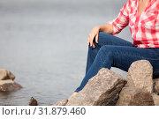 Concept image of female legs dressed jeans and body in red shirt against sea water, copyspace. Стоковое фото, фотограф Кекяляйнен Андрей / Фотобанк Лори