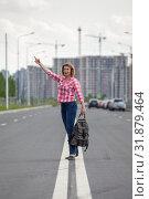 Купить «Middle age Caucasian woman waving hand for stop the car, standing on the median strip line of urban road», фото № 31879464, снято 21 июня 2019 г. (c) Кекяляйнен Андрей / Фотобанк Лори