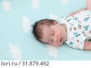 Купить «Portrait of sleeping baby one month old, lying on light blue bedsheet with white clouds, copy space», фото № 31879492, снято 18 июня 2019 г. (c) Кекяляйнен Андрей / Фотобанк Лори
