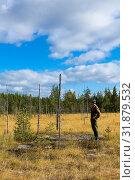Купить «Mature Caucasian man prospector standing and thinking on wetland, geologist», фото № 31879532, снято 4 сентября 2011 г. (c) Кекяляйнен Андрей / Фотобанк Лори