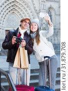 Купить «tourists taking selfie on mobile phone», фото № 31879708, снято 18 ноября 2017 г. (c) Яков Филимонов / Фотобанк Лори