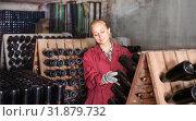 Купить «Wine maker taking care of seasoning bottles», фото № 31879732, снято 21 сентября 2016 г. (c) Яков Филимонов / Фотобанк Лори