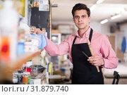 Купить «Joiner looking for necessary tools», фото № 31879740, снято 8 апреля 2017 г. (c) Яков Филимонов / Фотобанк Лори