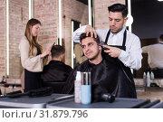 Купить «Hairdresser man doing styling of guy with electric hair clipper», фото № 31879796, снято 5 марта 2018 г. (c) Яков Филимонов / Фотобанк Лори