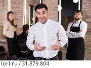 Купить «Satisfied man approving result of hairdresser work», фото № 31879804, снято 5 марта 2018 г. (c) Яков Филимонов / Фотобанк Лори