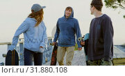 Купить «Front view of young caucasian skateboarders walking with skateboard at observation point 4k», видеоролик № 31880108, снято 16 октября 2018 г. (c) Wavebreak Media / Фотобанк Лори