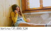 Купить «Front view of young caucasian woman talking on mobile phone in a workshop 4k», видеоролик № 31880124, снято 16 октября 2018 г. (c) Wavebreak Media / Фотобанк Лори