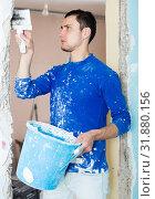 Купить «Construction worker with wall plastering tools», фото № 31880156, снято 21 мая 2017 г. (c) Яков Филимонов / Фотобанк Лори