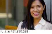 Купить «portrait of happy smiling asian woman», видеоролик № 31880528, снято 21 июля 2019 г. (c) Syda Productions / Фотобанк Лори