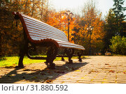 Купить «Осенний пейзаж. Autumn October landscape. Bench at the autumn park under colorful deciduous trees lit by bright sunlight», фото № 31880592, снято 17 октября 2018 г. (c) Зезелина Марина / Фотобанк Лори