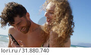 Купить «Romantic couple using mobile phone at beach 4k», видеоролик № 31880740, снято 14 ноября 2018 г. (c) Wavebreak Media / Фотобанк Лори