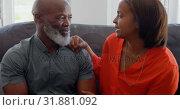 Купить «Front view of mature couple interacting with each other in living room at home 4k», видеоролик № 31881092, снято 7 ноября 2018 г. (c) Wavebreak Media / Фотобанк Лори